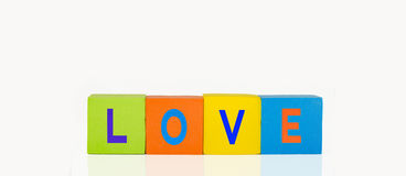 Colorful toy building blocks. Toy colorful building blocks in a line text love stock photography