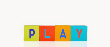 Colorful toy building blocks. In a line text play royalty free stock photos