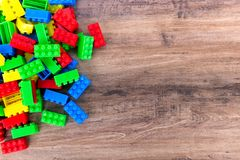 Colorful toy building blocks. Top view of colorful toy building blocks on wood background with copy space royalty free stock images