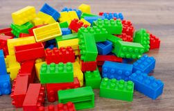 Colorful toy building blocks. On wood background stock image