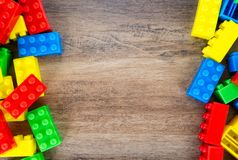 Colorful toy building blocks. On wood background stock photos