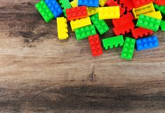 Colorful toy building blocks. On wood background with copy space royalty free stock photography