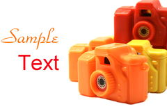 Colorful Toy Cameras with copy space Stock Photography