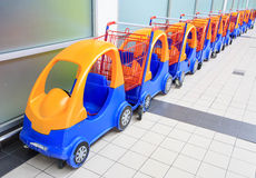 Colorful toy car as trolley in row. Many Colorful toy car as trolley for shopping in row Stock Photography
