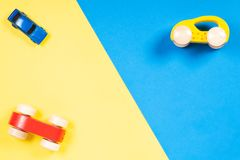 Colorful toy cars on blue and yellow background.  Royalty Free Stock Images