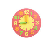 Colorful toy clock in textured foam Stock Photo