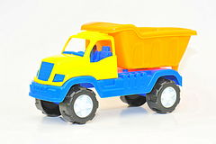 Colorful toy dumper on white background Royalty Free Stock Images