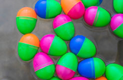 Colorful of toy egg float on water Royalty Free Stock Images