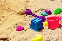 Colorful plastic toy kids with sand background. royalty free stock photography