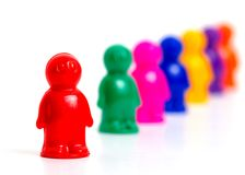 Colorful toy people standing in a queue. Colorful toy people group in queue on white background Royalty Free Stock Photos