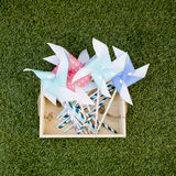 Colorful toy pinwheel against green grass background Royalty Free Stock Photography