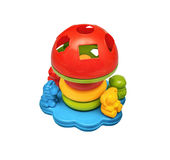 Colorful toy puzzle sorter with cutouts for objects of different shapes Stock Photo