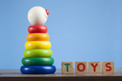 Colorful toy pyramid with clown's face Royalty Free Stock Photo