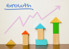 Colorful toy with rising graphic diagram for Growth Stock Photo