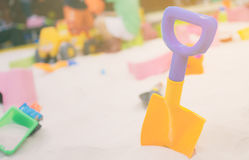Colorful toy shovel in sandbox. Colorful toy shovel in children sandbox Stock Photography