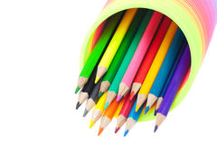 Colorful toy spring and colored pencils Stock Photos