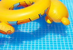 Colorful toy swimming tire at the pool Stock Photo