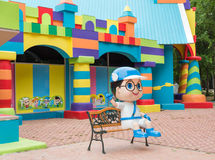 Colorful toy town building with coloful blocks and a boy cartoon Royalty Free Stock Image