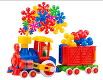 Colorful toy train with incredible steam Stock Photo