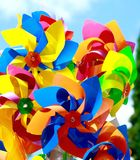 Colorful toy windmills. And other toys Royalty Free Stock Photos