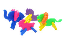 Colorful toys. Many colorful plastic toys in various shapes of animals  isolated on white Stock Photo