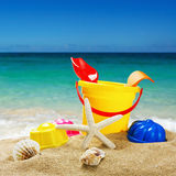 Colorful toys for childrens sandboxes against the sea Stock Images