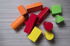 Colorful toys, geometric shapes. Made of wood, placed on wooden floor stock photography