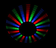 Colorful trace rotating LED in form of a disc. On a black background royalty free illustration