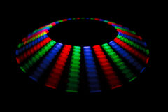Colorful trace rotating LED in form of a disc. On a black background vector illustration
