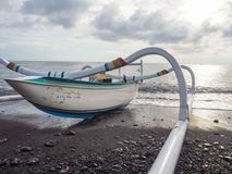 Colorful traditional Balinese fishing boat called jukung on the stock image