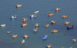 Colorful traditional boats float on the sea Royalty Free Stock Images