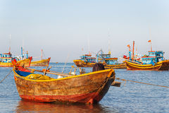 Colorful traditional fisher boats. Mui Ne, Vietnam. Royalty Free Stock Photo
