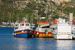Colorful traditional fisher boats at a pier. Port of Mgarr Stock Photography