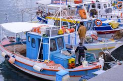 Colorful traditional fishing boats docked at the old Venetian port in Heraklion city stock image