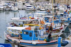 Colorful traditional fishing boats docked at the old Venetian port in Heraklion city royalty free stock photography