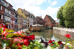 Colorful traditional french houses on the side of river Colmar. July 1,2016 - Colorful traditional french houses on the side of river Colmar, France, Alsace royalty free stock images