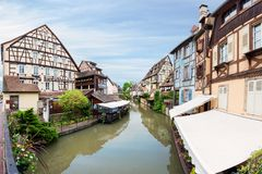 Colorful traditional french houses on the side of river Lauch in Royalty Free Stock Image