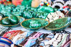 Colorful traditional handmade african malachite eggs, beads and leather necklaces, braceletes and other accessories at local craft stock photos