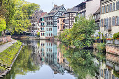 Colorful traditional houses reflecting in river Ill in Strasbour Stock Image