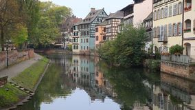 Colorful traditional houses reflecting in river Ill in Strasbourg stock video