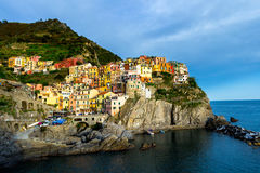 Colorful traditional houses on a rock over Mediterranean sea, Ma Stock Photography
