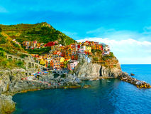 Colorful traditional houses on a rock over Mediterranean sea, Manarola, Cinque Terre, Italy Royalty Free Stock Photo