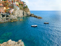 Colorful traditional houses on a rock over Mediterranean sea, Manarola, Cinque Terre, Italy Stock Image