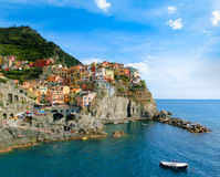 Colorful traditional houses on a rock over Mediterranean sea, Manarola, Cinque Terre, Italy Stock Photography