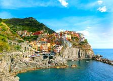 Colorful traditional houses on a rock over Mediterranean sea, Manarola, Cinque Terre, Italy Royalty Free Stock Image