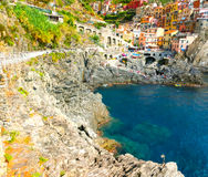 Colorful traditional houses on a rock over Mediterranean sea, Manarola, Cinque Terre, Italy Stock Photo