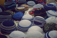 Colorful traditional jewish yarmulke piles for sale at the old city of Jerusalem, Israel Royalty Free Stock Photos