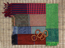 Colorful traditional khmer scarfs and beads Stock Photos