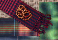 Colorful traditional khmer scarfs and beads Royalty Free Stock Photos