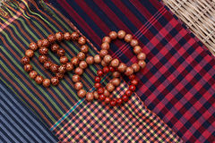 Colorful traditional khmer scarfs and beads Stock Photo